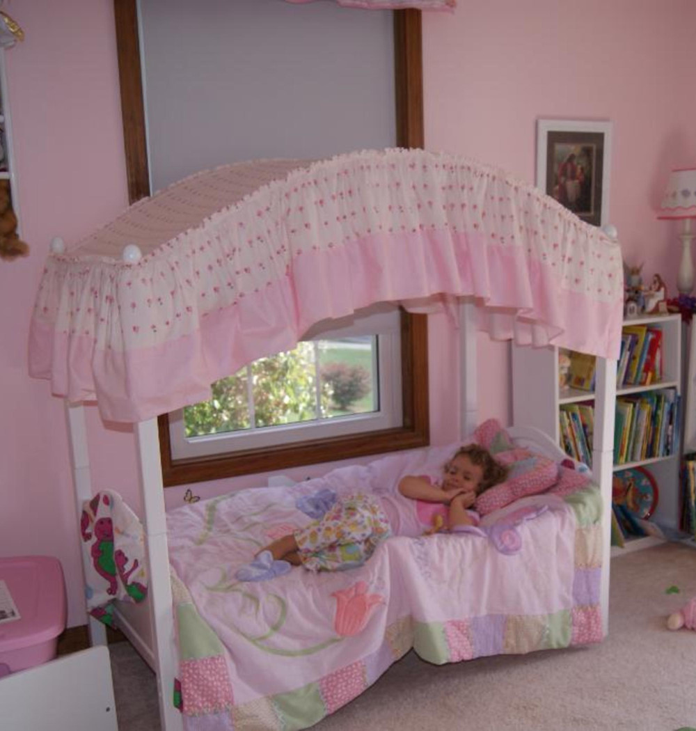 Super cute pink canopy toddler bed