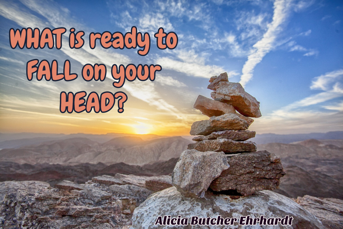 Pile of rocks on mountain. Text: What is ready to fall on your head? Alicia Butcher Ehrhardt